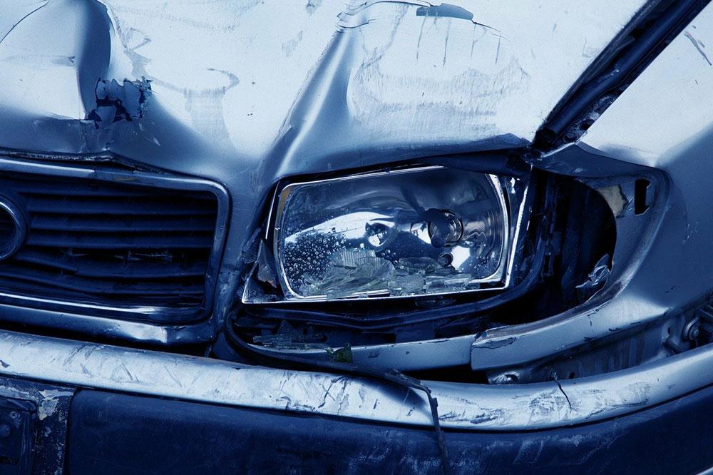 close up of damaged vehicle headlight
