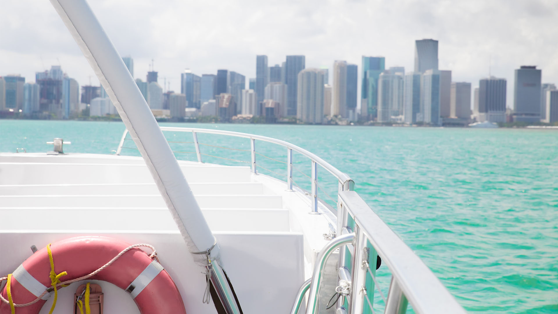 view of cityscape from small boat with life preserver