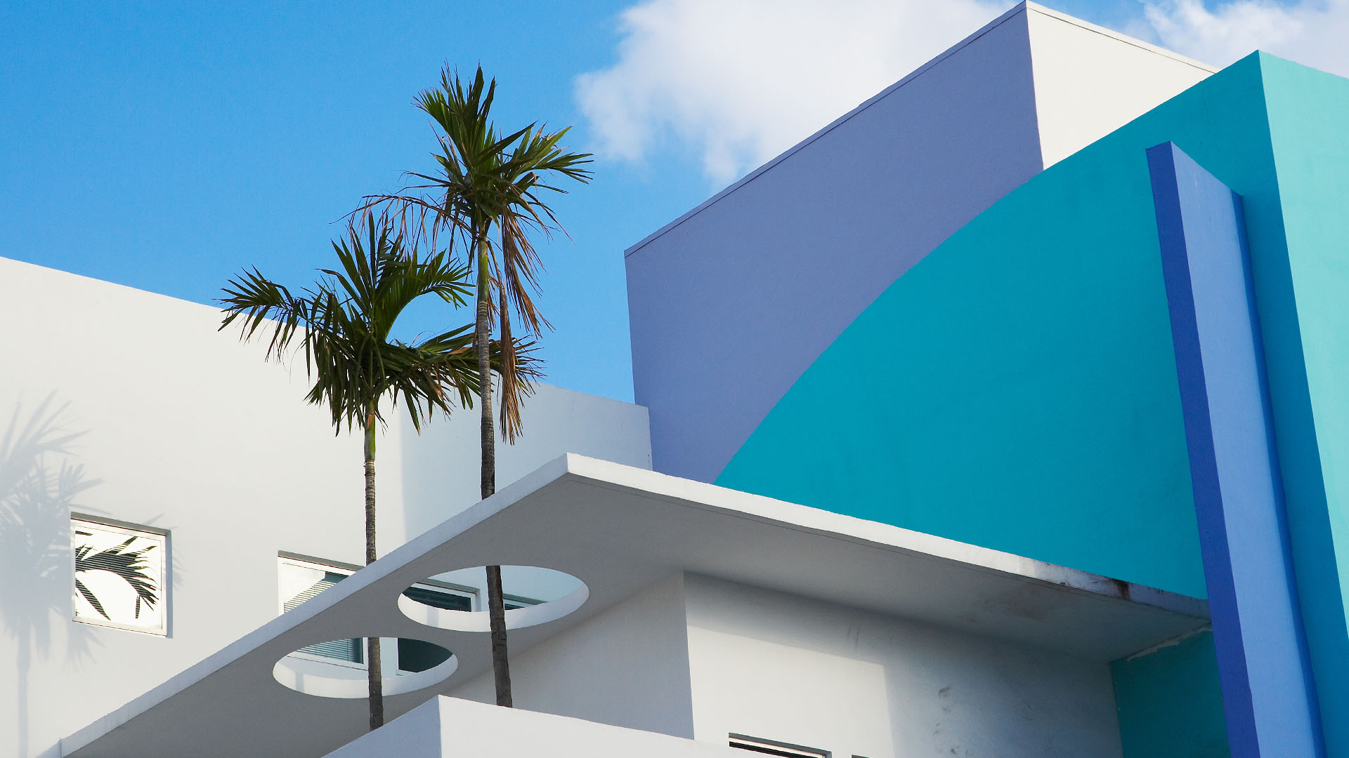 abstract view of art deco building with palm tree