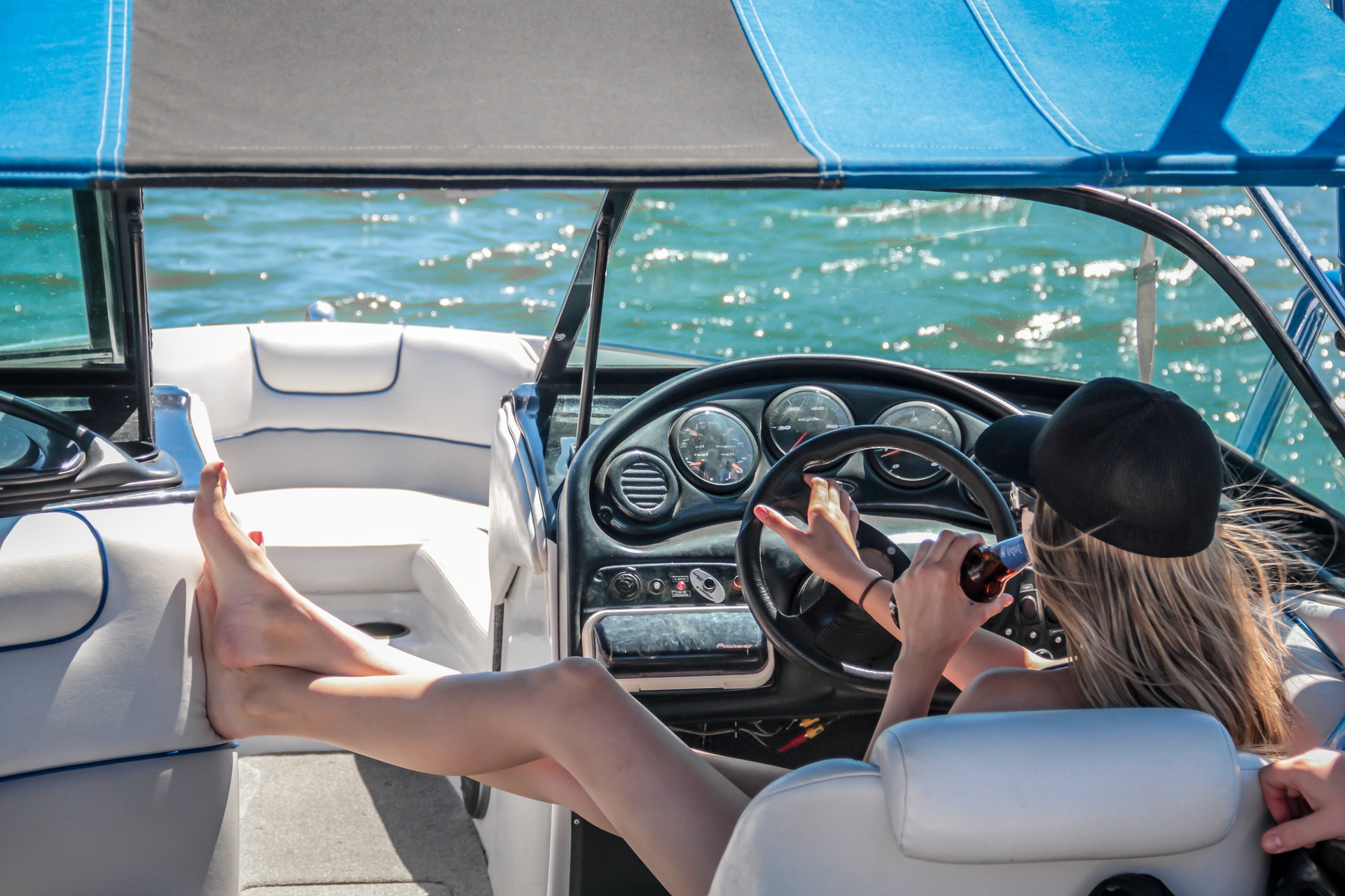 Woman Drinking While Driving Speedboat